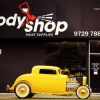 A beautiful yellow car in front of our Body Shop Paint Supplies Bayswater store with a fresh coat of carnauba wax.